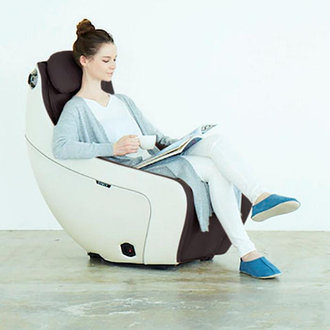 Synca Wellness CirC Massage Chair in coffee with model reading