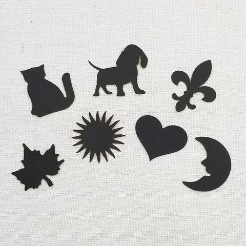 assorted match striker shapes - cat, dog, fleur de lis, maple leaf, sunburst, heart, moon