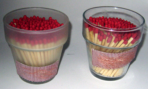 red matches in small flower pot glass vases with a match striker strip on the side