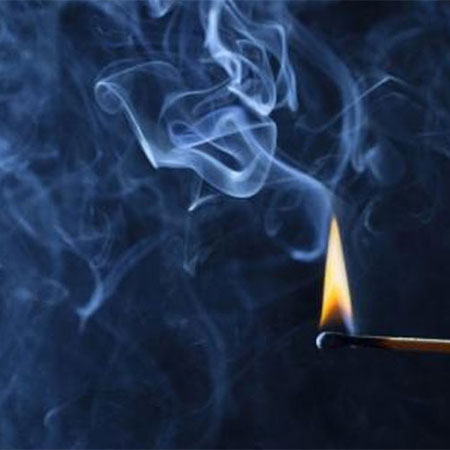 matchstick burning with smoke going up