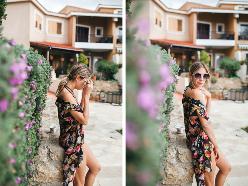 floral dress and flower bushes