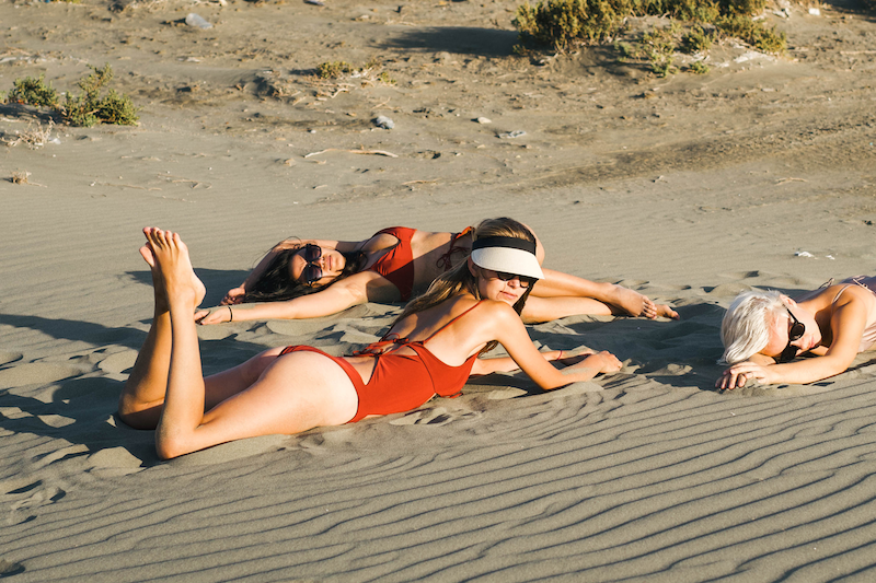 girls frolicking in the sand