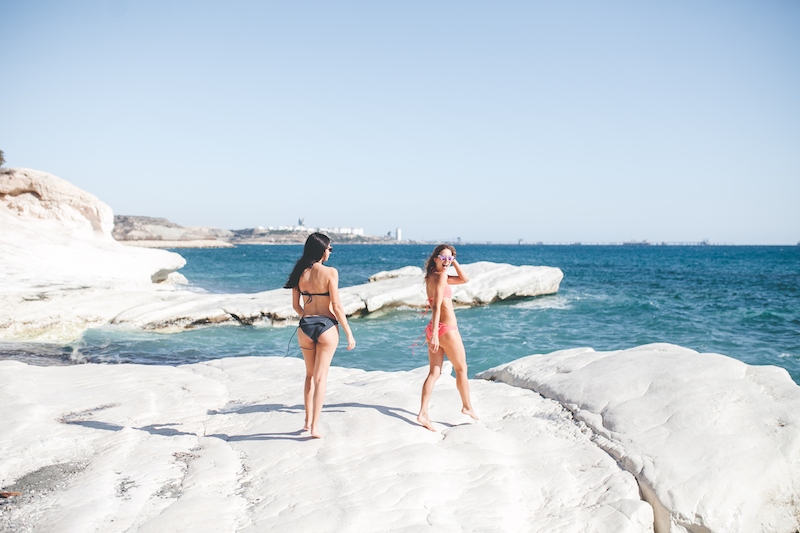 girls on a white stone beach