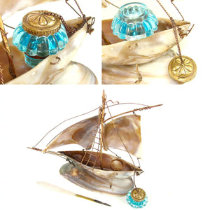 Antique French mother of pearl inkstand, electric blue glass inkwell, in the form of a sail boat