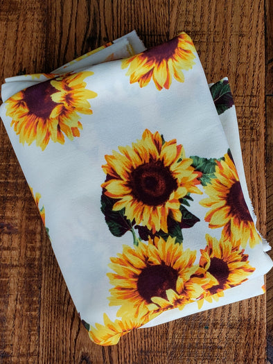 Sunflower on Ivory Scuba Crepe Poly Spandex(LAST YARDS- NOT CONTINUOUS)