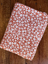 Ivory Mini Flowers FIELD on Terracotta Double Brushed Poly Spandex(LAST YARDS- NOT CONTINUOUS)
