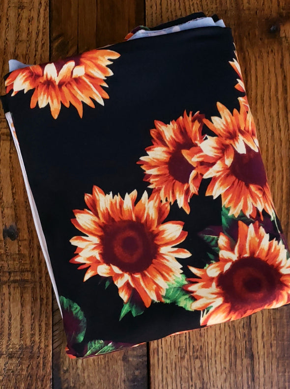 Sunflower on Black Double Brushed Poly Spandex