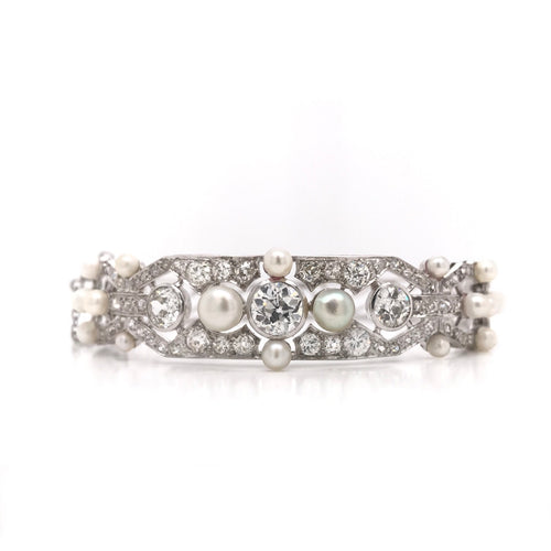 2.5 CARAT DTW DIAMOND AND PEARL BANGLE