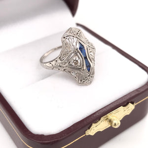 ART DECO CUSTOM CUT SAPPHIRE AND DIAMOND FILIGREE RING.