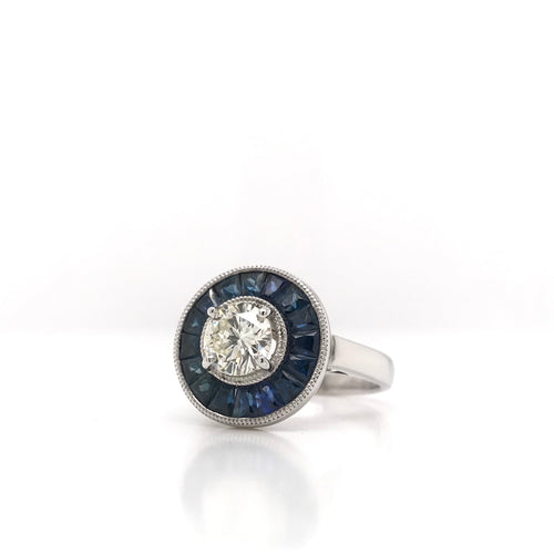ANTIQUE INSPIRED 0.87 CARAT DIAMOND AND SAPPHIRE PLATINUM RING
