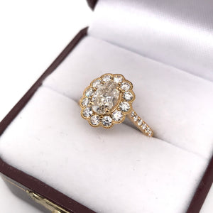 1.17 OVAL CUT DIAMOND HALO STYLE COMTEMPORARY RING