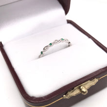 ANTIQUE STYLE EMERALD AND DIAMOND ETERNITY BAND
