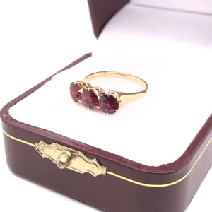 THREE STONE GARNET RING