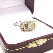 1.36 DTW CLASSIC THREE STONE YELLOW AND WHITE DIAMOND RING