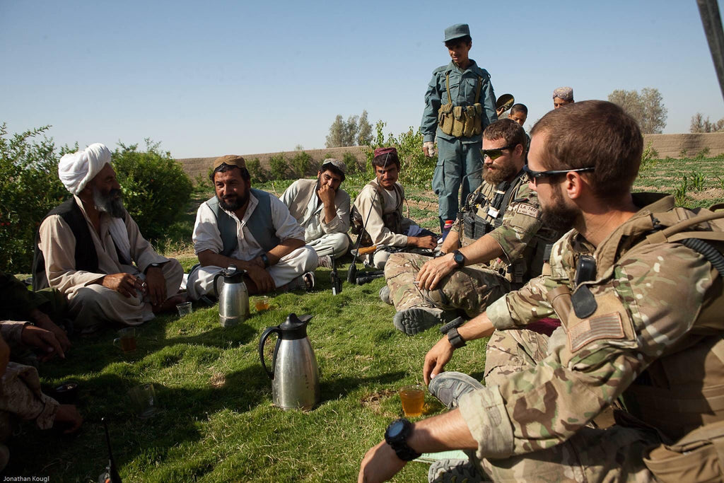 U.S. soldiers drinking tea with Afghans