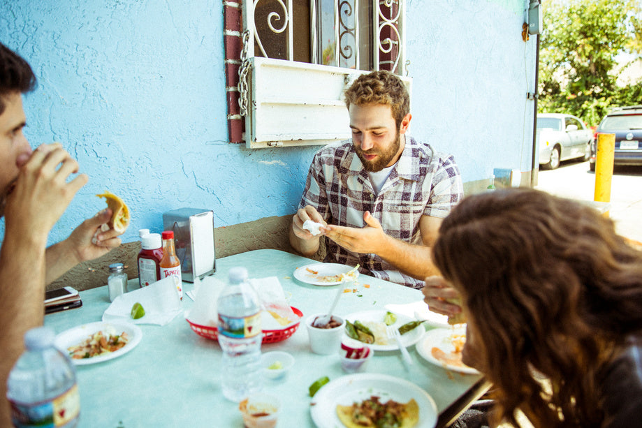 Daniel Norris wearing the Outerknown Summer Camp shirt while eating with friends