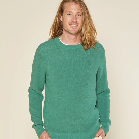 Man in Outerknown sweater