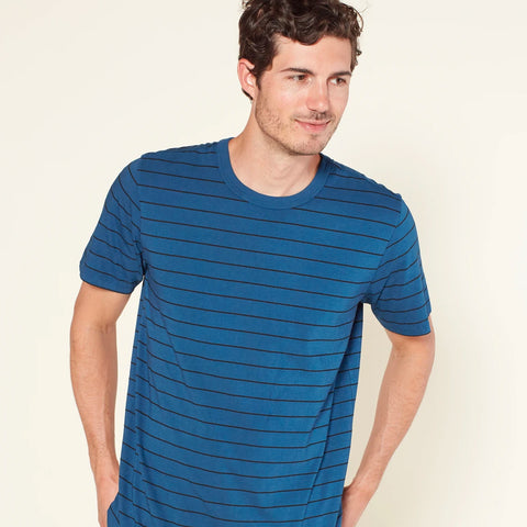Man in blue Outerknown tee shirt