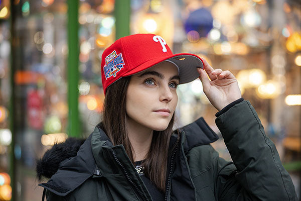 Lady with red a cap.