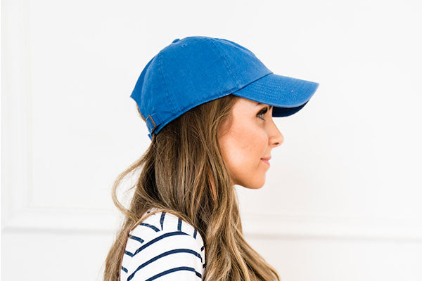 Mom style baseball cap and striped dress