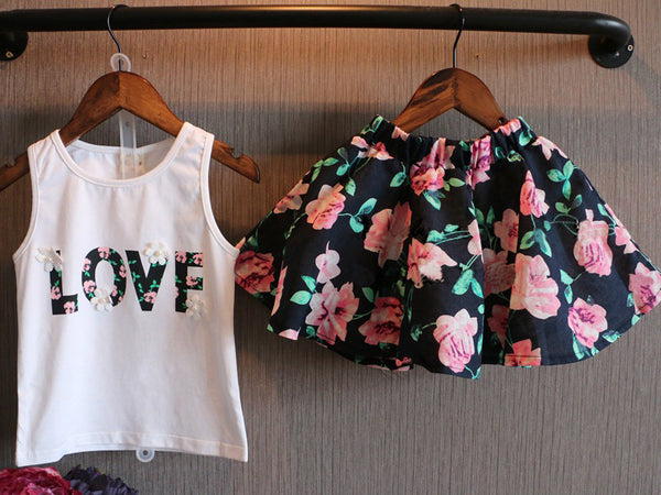 pink and black floral print skirt with matching white tank top with letter print floral letters design - Here Comes A Baby