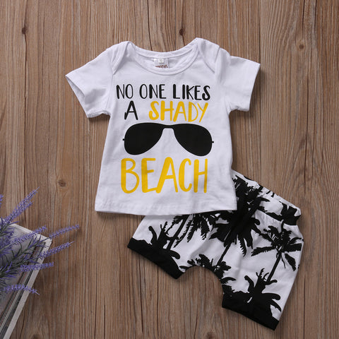 If this one doesnt make you laugh you really gotta get out more....Like to the beach and have some fun. This 2 piece set includes a white printed tshirt and black pineapple print shorts. - Here Comes A Baby