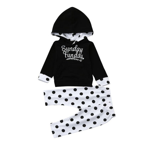 Black & white sweat outfit with black hoodie sweatshirt and polka dot pants. - Here Comes A Baby