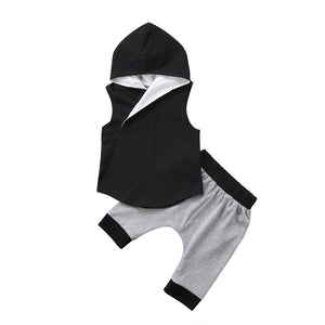 2 piece grey and black hoodied set. Its sleeveless tank top and short keep you cool for the summer but the added hood helps keep the sun off your kiddos neck and face. - Here Comes A Baby