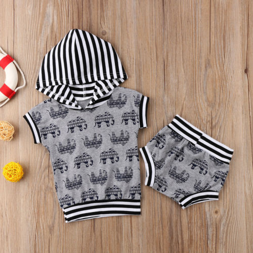 2 piece hooded cutoff shirt sleeve with matching elephant print shorts. - Here Comes A Baby