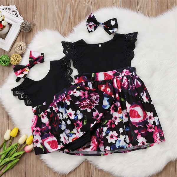 matching big sister little sister black floral dress and romper with lace sleeves and headband included - Here Comes A Baby