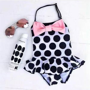 Get ready for the summer in One piece girls swimsuit with pink bow, black polka dots, ruffle and thin strap. - Here Comes A Baby