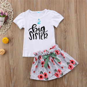 little sister big sister set. white tshirt or ones with matching floral skirt and pants & headband for little girl siblings - Here Comes A Baby