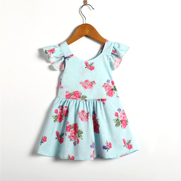 This Light blue Girls dress with flowers has a bowknot tie back ruffle sleeve and a flutter skirt to make this dress looking oh so cute on every little girl who tries it on. - Here Comes A Baby