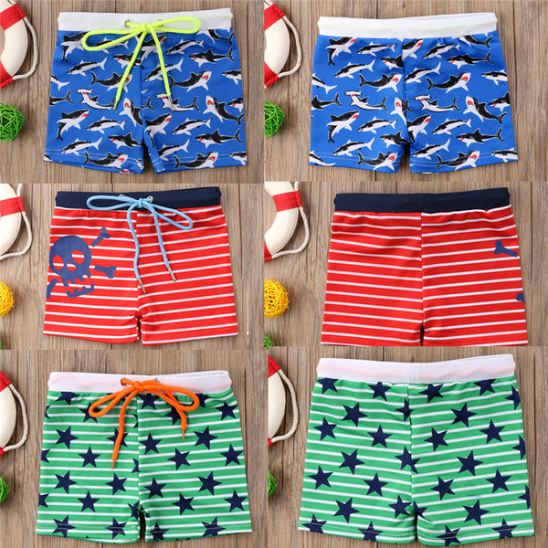 Summer Time is just around the corner and you know your little man is going to need a new pair of swim shorts. These 4 color print board short come in a stretchy style fabric much like that of your Mommy swimsuits to make it extra easy to put on and off o - Here Comes A Baby