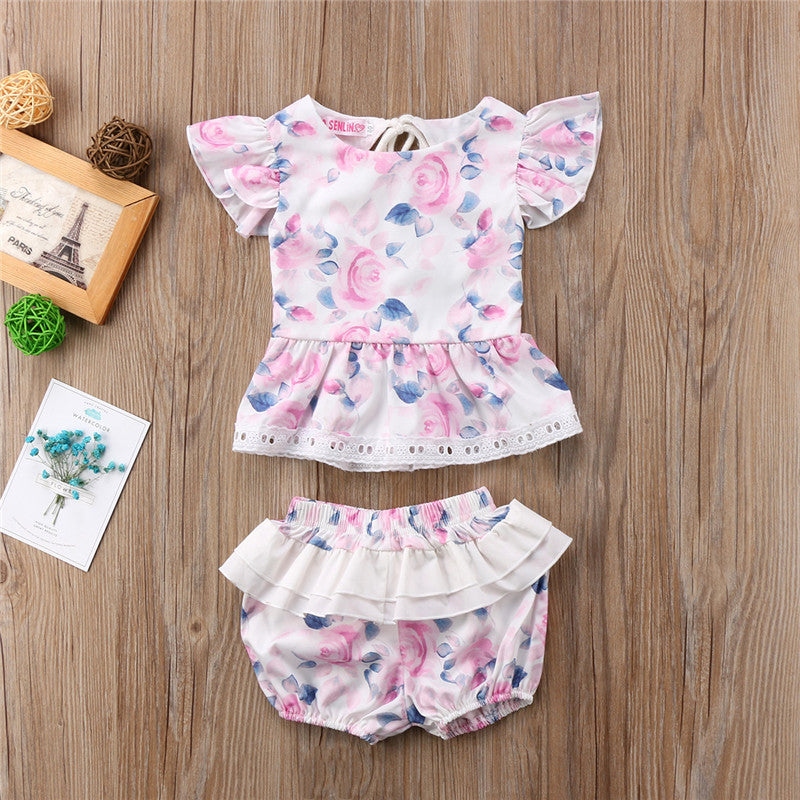 This 2 piece girls set with ruffle design shorts and peekaboo back this outfit is just the right combo for those hot summery days - Here Comes A Baby