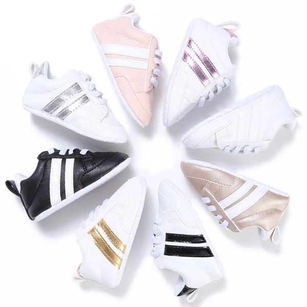 Adidas Style baby shoe available in 8 different colors with 2 stripes, straight laces and soft booties for babies ranging NB-18M. - Here Comes A Baby