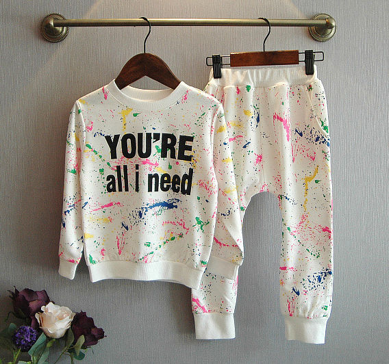 2 piece sweatshirt and sweat pants set with printed quote and neon splatter paint design - Here Comes A Baby