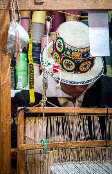 Artisan creating fair trade sustainable clothing on traditional loom
