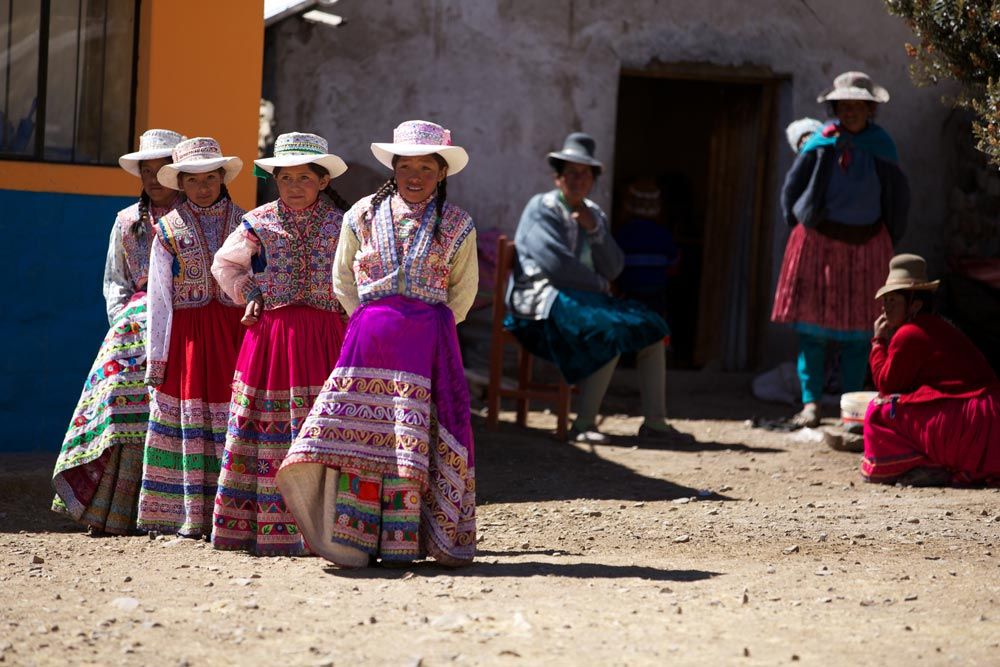 Children dance in the Highlands wearing ornate traditional Peruvian textiles
