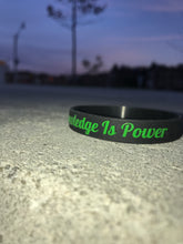 "Green & Black ""Knowledge Is Power"" Wristband"