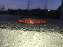 "Red & Black ""Knowledge Is Power"" Wristband"