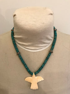 Turquoise with large bird