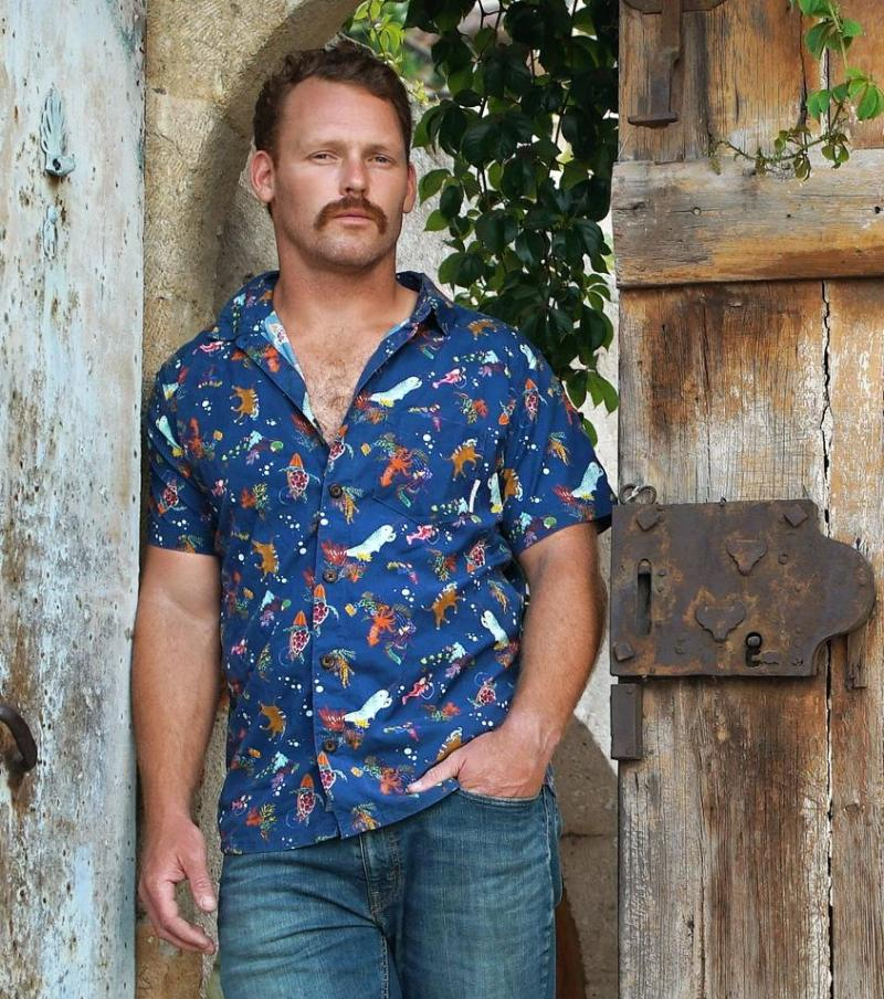 Baja Llama, Narwalled short sleeve button up mens Hawaiian shirt in front of old door