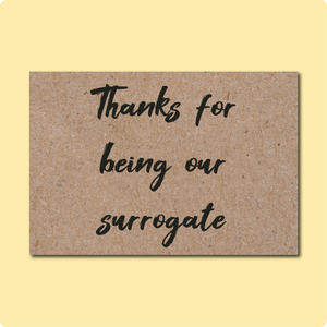 Thanks for being our surrogate Greeting Card. Script Text in black font on a Kraft brown card.