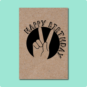 Happy Birthday Peace Sign Card on Australian recycled Kraft Brown paper with black font of hand peace sign in sun with curvature happy birthday font