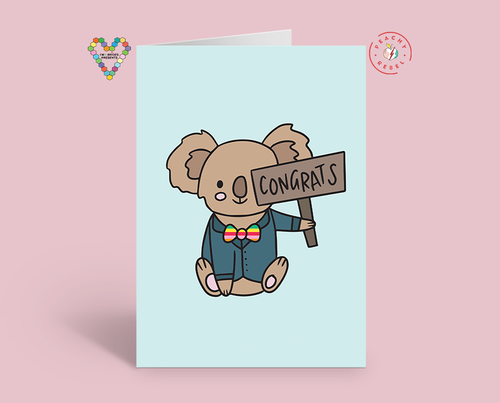 Koala with rainbow bow tie holding up a congrats sign greeting card
