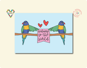 Two rainbow lorikeets holding up a sign welcome to the world greeting card