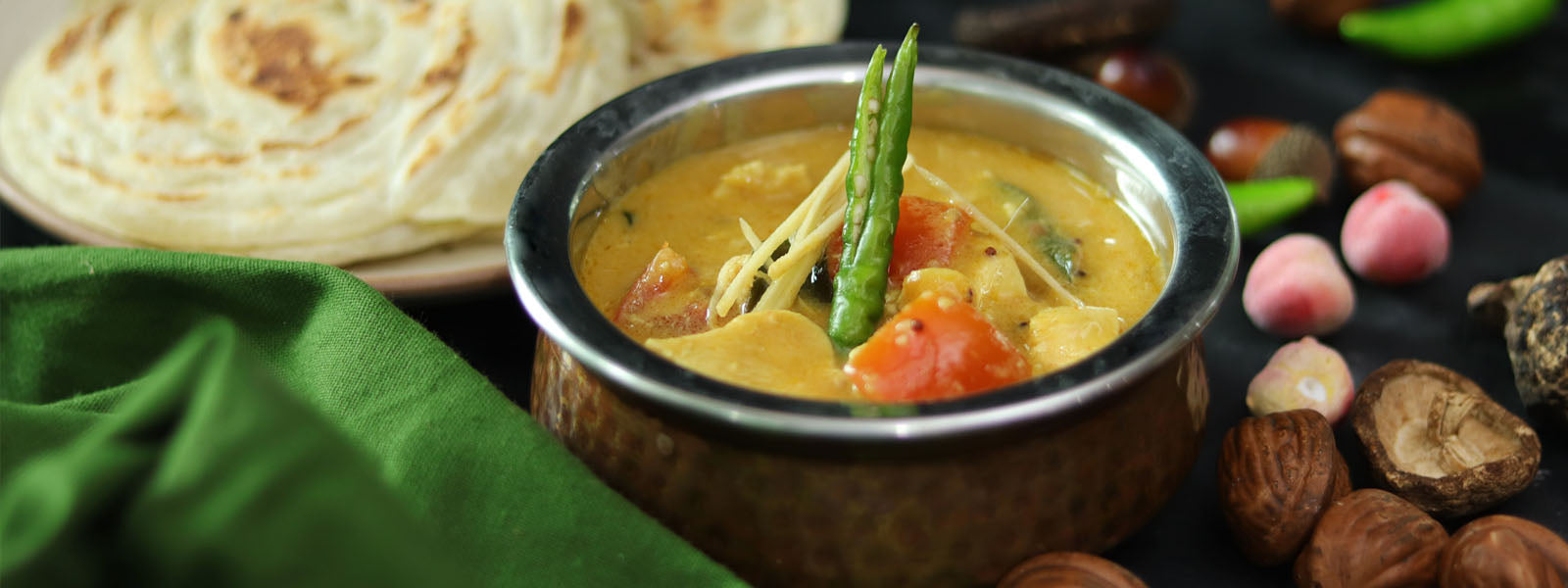 Coconut Chicken Curry With Malabar Parotta