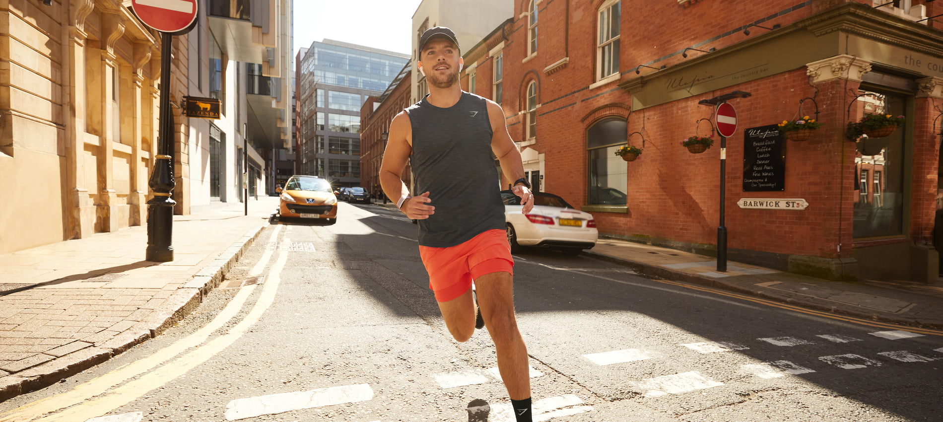 Male model running outside in the new Speed Collection.