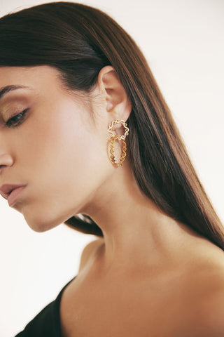 Woman wearing double hoop large swirly earrings
